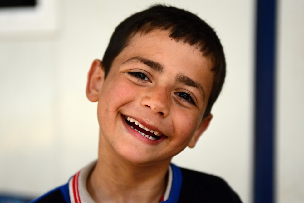 Series of portraits of children syrian refugees